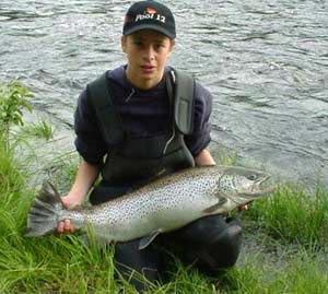Andreas Andersson with a fine Byske trout. 7.65kg weight 2001